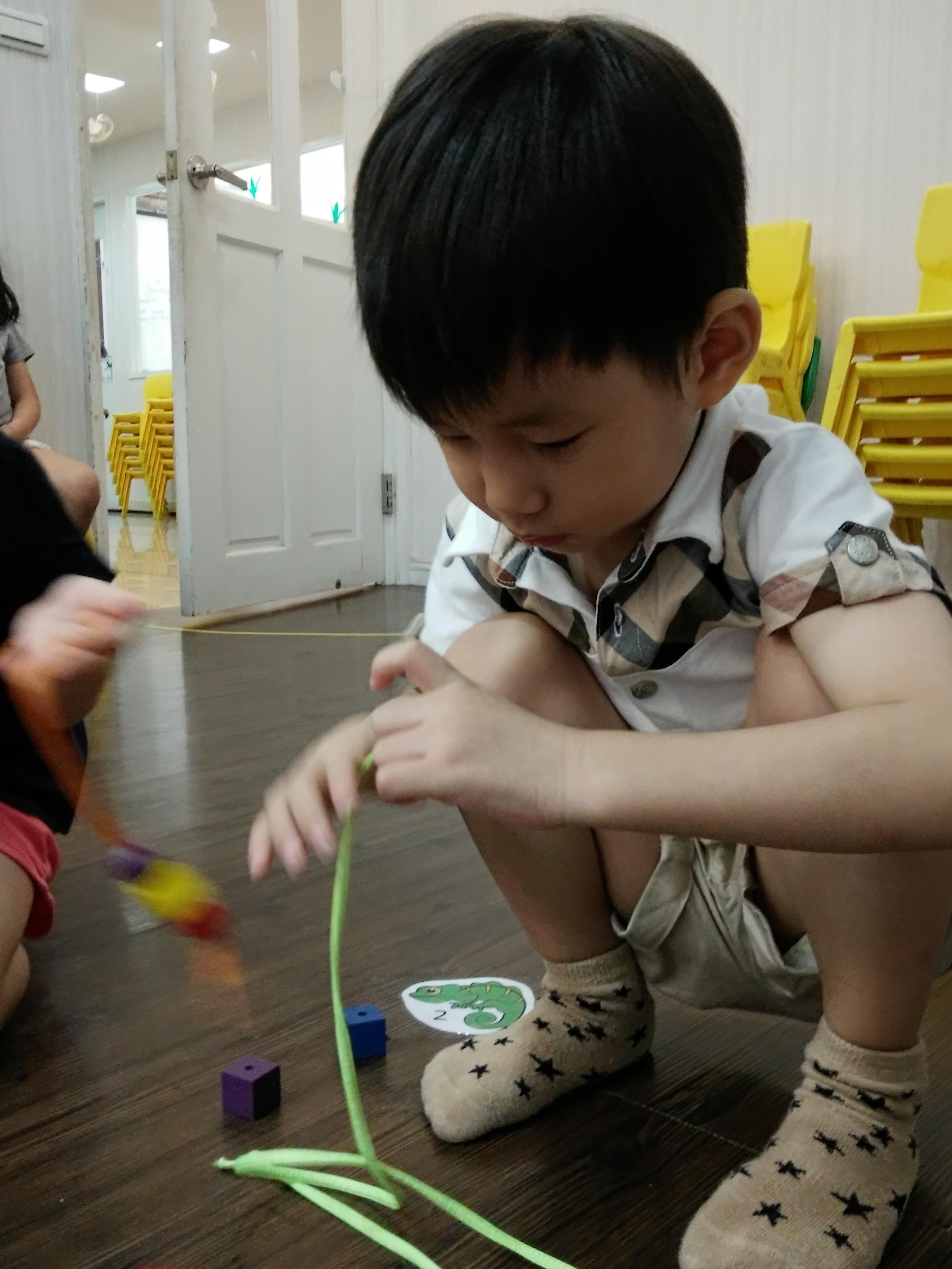 Geoffrey threading beads2