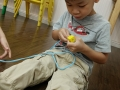 Ryan threading beads 2